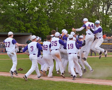 Avon players jump for joy after knocking off top-seeded Amherst 2-1 in the Division I district final Thursday at The Pipe Yard in Lorain. The Eagles captured the program's first district championship.  JESSE GRABOWSKI / CHRONICLE