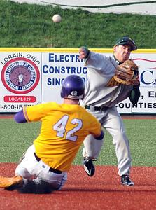 Amherst's Maximo Meggitt throw for a double play on Avon runner Ryan Rogers in second inning on Mar. 27.  Steve Manheim