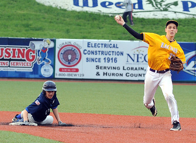 Avon Ryan Poyle applies the force out to Bay Marty Schreuger  in third inning May 12.  Steve Manheim