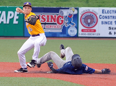 Avon Adam Horrocks applies the force out to Bay Marty Schreuger in third inning May 12.  Steve Manheim