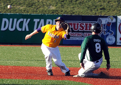 Holy Name Gordy Egan steals second before the throw reaches Avon Mike Blanc in third inning on Mar. 29.  Steve Manheim