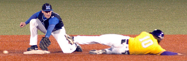 Avon's #10 Matt Eckhardt slides safely into 2nd as the ball gets by Midview's #12 Cody Callaway.