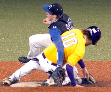 Avon's #10 Matt Eckhardt gets tangled up with  Midview's #12 Cody Callaway after sliding safely into 2nd