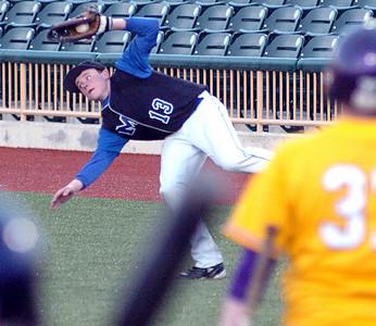 Avon's #37  Zach Allen watches Midview's #13 Steven Frye make a twisting catch of his pop foul ball.