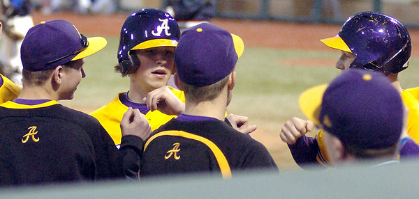 Avon's #10 Matt Eckhardt is gets fist pumps from teammates after scoring.