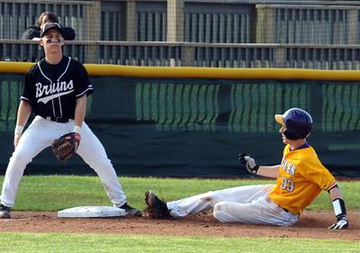 Avon Ryan Poyle slides safe into third base before the throw to Padua Nick Hoy in third inning May 19.  Steve Manheim