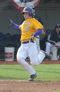 Avon Matt Eckhardt slides safe to score in second inning May 19.  Steve Manheim