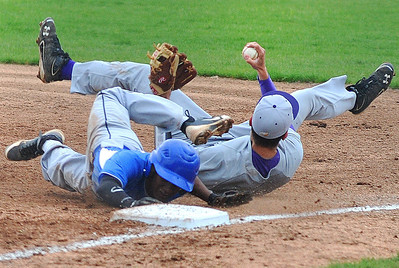 Avon second baseman Brian Baker dives to tag out Bay Village's Will Wilson during a rundown. KRISTIN BAUER | CHRONICLE