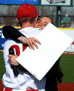 Elyria High student Ali Naogtte hugs Elyria player Jake Csizmadia after asking him to attend prom. STEVE MANHEIM/CHRONICLE