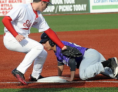 Avon's Christian Giraldo is safe at third on a bad throw to Elyria's Jaeger Shaffstall in the fourth inning, Giraldo went on to score on the play. STEVE MANHEIM/CHRONICLE