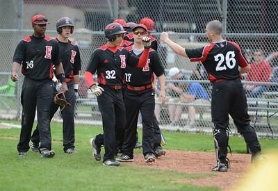 Elyria players celebrate a successful inning against Avon Lake High School on Saturday. KRISTIN BAUER | CHRONICLE