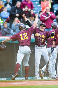 Avon Lake's Brad Hamilton, left, and David Winkel celebrate after Hamilton scored in the bottom of the second inning. JUDD SMERGLIA/CHRONICLE