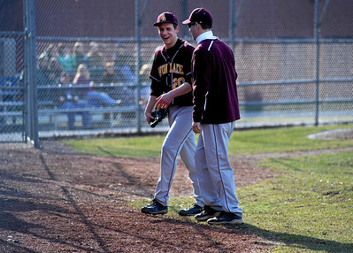 After a perfect three up, three down inning against Westlake High School, Avon Lake High School pitcher Logan DeLong (20) is congratulated by teammates and coaches on Tuesday afternoon, April 8 at Avon Lake High School.