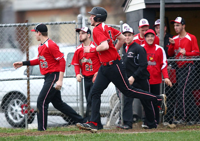 The Cardinals' dugout empties as Eric Vraja heads for home plate after hitting a three-run home run during the second inning against Black River. AARON JOSEFCZYK/CHRONICLE