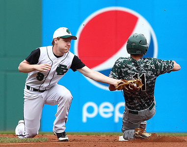 Elyria Catholic second baseman Christian Stanziano tags out Highland's Zac Melchiorre attempting to steal Sunday during the Panthers' 12-2 win at Progressive Field. AARON JOSEFCZYK/CHRONICLE