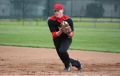 Elyria first baseman Brodie Stewart snags the hit for the out. CHRISTY LEGEZA/CHRONICLE
