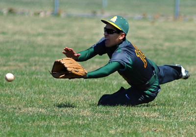 Amherst right fielder Aaron Soto dives in an attempt to field a fly ball. KRISTIN BAUER | CHRONICLE