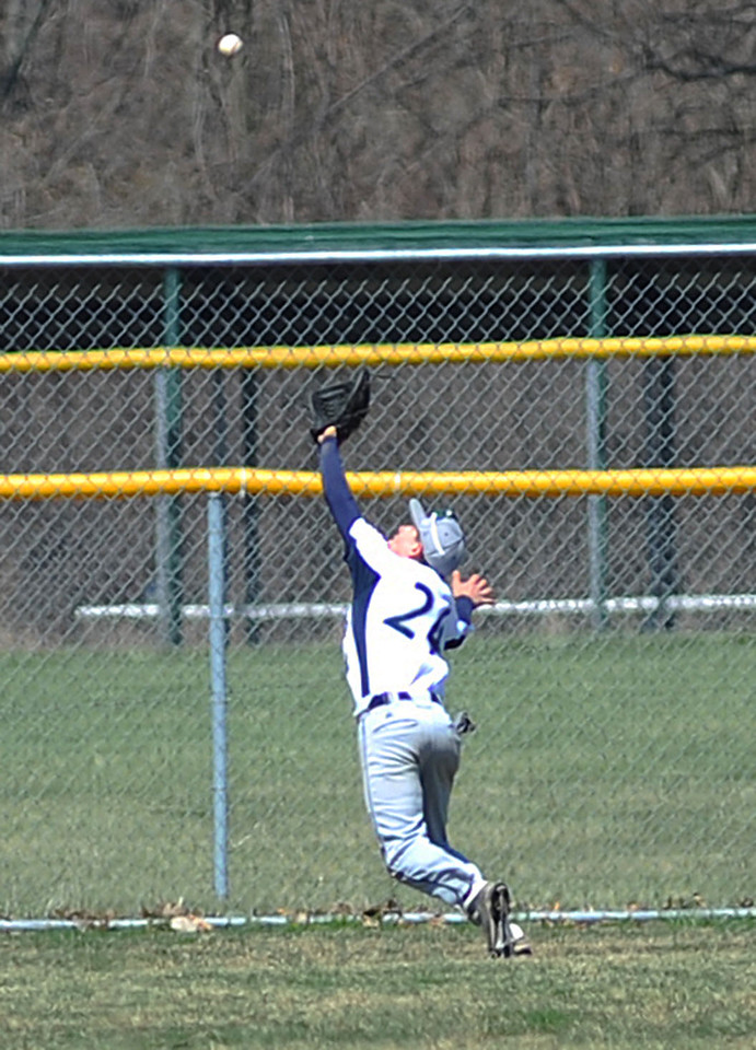 Lorain left fielder Branden Bartlome chases a fly ball hit deep into left field, and makes the catch. KRISTIN BAUER | CHRONICLE