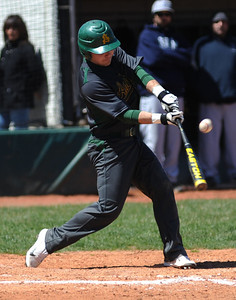 Amherst's Zack Bires bats against Lorain. KRISTIN BAUER | CHRONICLE