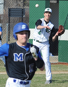 Elyria Catholic pitcher Andrew Abrohamowicz throws to first on a bunt by Midview's Cole Franks. STEVE MANHEIM/CHRONICLE