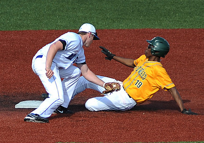 Midview shortstop Cody Callaway attempts to tag St. Edward's Devin Stanley, who was trying to steal second. KRISTIN BAUER | CHRONICLE