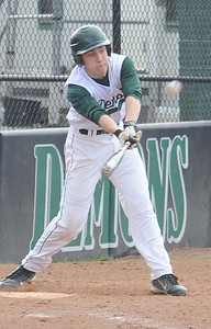 Westlake's Evan Davis hits a two-run RBI double in the second inning. STEVE MANHEIM/CHRONICLE