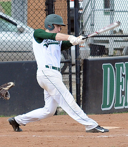 Westlake's Kent Axcell hits an RBI double in the first inning. STEVE MANHEIM/CHRONICLE