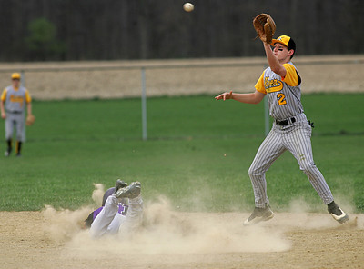 7APR10 Keystone's #21 Jim Reid dives safely into second base on a steal; Black River's #2 Tim Sexton takes a late throw.  photo by Chuck Humel