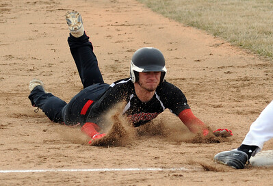 Brookside Dud Taw steals third base Mar. 31.  Steve Manheim