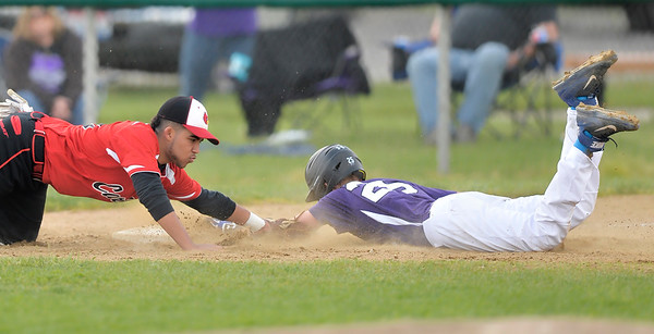 Keystone's Kevin Mealwitz slides safely into third base before a tag by Brookside's #13. DAVID RICHARD / CHRONICLE