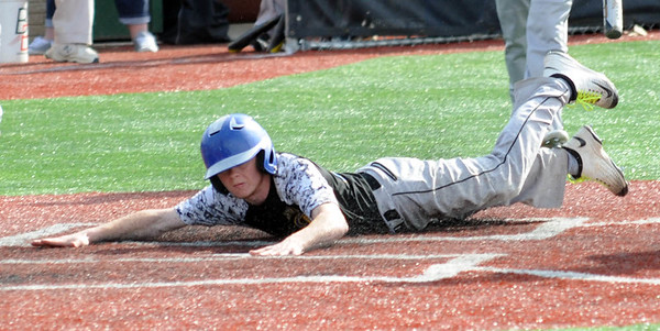 Clearview's Justin Lilly slides safely into home on a passed ball to score in the third inning May 16.  STEVE MANHEIM/CHRONICLE