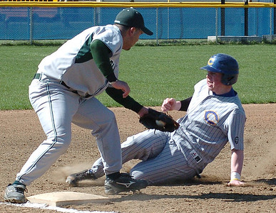 4-10-10 linda murphy  bot of 1st - EC's #12 guards 3rd base as he tags out Clearview's #8.
