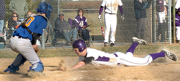 Vermilion's #12 Garrett Koutsopoulos slides into home as Clearview's #10 Jack Bennett tries to guard the plate. Garrett was called safe.