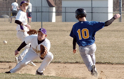 Vermilion's #29 Nick Dlugosz waits for the ball with #17 Caleb Waller backing him up as Clearview's #10 Jack Bennett slides into second. Jack was called out.