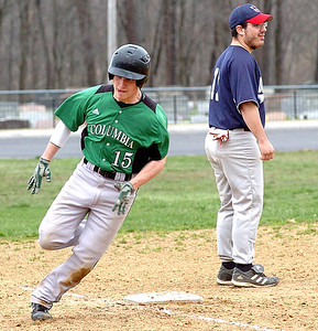 Columbia's #15 Sean Nagle runs around third heading for home to score, passing Oberlin's #11 Thomas Brewster.