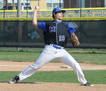 Derek Delumba pitches for Midview on April 20. STEVE MANHEIM/CHRONICLE