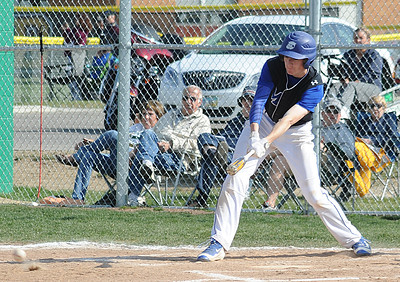 Midview's Curtis Caithaml hits an RBI single in the first inning April 20. STEVE MANHEIM/CHRONICLE