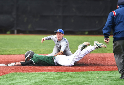 KRISTIN BAUER | CHRONICLE Elyria Catholic High School's Brendan Holley (6) slides safely into second base as Bay High School short stop Ryan Keane (2) fails to lay the tag in time on Tuesday afternoon, May 2.