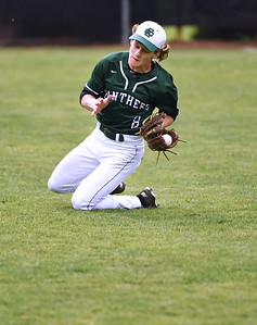 KRISTIN BAUER | CHRONICLE Elyria Catholic High School left fielder Jace Drwal (8) dives to catch a popfly during a game against Bay on Tuesday afternoon, May 2.