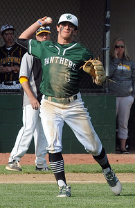 Elyria Catholic's Brendan Holley makes a throw to first May 10.  STEVE MANHEIM / CHRONICLE
