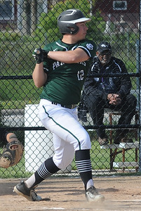 Michael Nedwick hits an RBI double for Elyria Catholic in third inning May 10. STEVE MANHEIM / CHRONICLE