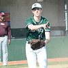 Elyria Catholic pitcher Jack Walsh throws to first April 12.  STEVE MANHEIM / CHRONICLE