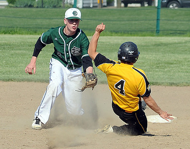 EC Dan Whitacre tags out Black River Branden Tomes on a steal attempt in third inning May 15.  Steve Manheim