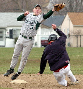 Top of 3rd — EC's #3 Stephen Saddler leaps to catch the throw to 2nd as Chanel's #17 Matt Sarosy steals the base.