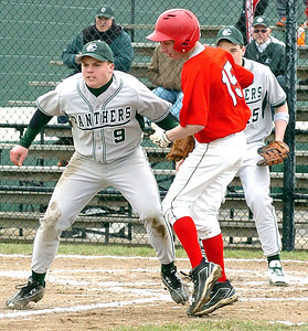 Top of 2nd — EC's pitcher #9 Tom Strasko tags out Chanels #15 Mike DeCesare in a squeeze play at home with EC 1st baseman #15 Kyle Robinson ready to back him up.