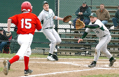 Top of 2nd - EC's pitcher #9 Tom Strasko waits for the ball at home to tag out Chanels #15 Mike DeCesare in a squeeze play with EC 1st baseman #15 Kyle Robinson ready to back him up.