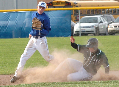 Midview's #1, Ben Simkovich, steps on second, tagging out EC's #8 Dan Whittacre.