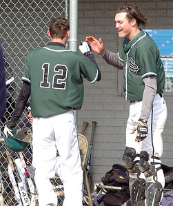 EC's #12, Zack Brosky, is greeted by #14, Ryan Rock, after safely crossing home plate.