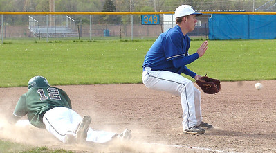 EC's #12, Zack Brosky, leaps back safely to third as Midview's #8, Andrew Novotny, waits for the ball.