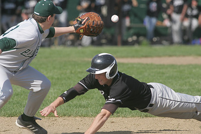 Elyria Catholic's #23 First Baseman Kyle Robinson takes a pick-off throw but Padua's #7 Tyler Stepp just beat the tag.  photo by Chuck Humel